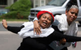 Friends and relatives of the Gezaee family react outside the Rain Tree  Codominium Complex  in...