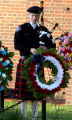 Denver Sheriff Deputy Jeremy Heinrichs (cq)  plays a bagpipe during the annual Fallen Officer...
