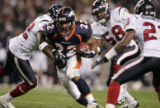 (DENVER, Co., SHOT 8/27/2004) The Denver Broncos' #22-Quentin Griffin runs through the defense of...