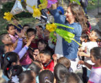 First grade teacher Denia Vargas (cq) helps break apart a pinata during the last day of classes at...