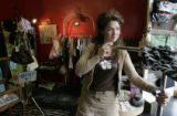 Owner/designer Crystal Sharp of She She adjusts a stand in her shop as we look at two blocks of...
