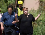 Julie Guzman (cq) ,walks with Denver Fire Lt. Phil Champagne (cq) and members of the  Underwater...