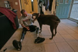 The ever faithful family dog Hershey comes the side of Tyler Carron (CQ), 18, exausted after...