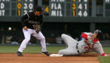 Rockies Kazuo Matsui, 2nd base, drops ball, in the top of 2nd inning, after forcing out Cardinals...