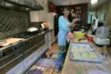 Erin Butler finishes up her empanadas in her effiecient kitchen in Denver, Colo.on Wednesday, May...