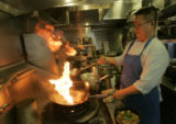 tBilly Lam owner and chef of Chef's Noodle House cooks it up on the stove, in Aurora, Colo.on...