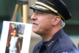 Aurora Police Chief Dan Oates (cq) stands beside a photo of Aarone Thompson during a press...