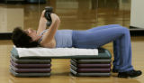 (DENVER, Colo., Aug. 24, 2004)  Exercises for the arms.  (photo by ELLEN JASKOL/ROCKY MOUNTAIN...