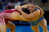 (ATHENS, GREECE-AUGUST 25, 2004) United States' wrestler, Rulon Gardner, of Afton, Wyo., right,...
