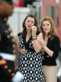 Julie Walsh, left, wife of U.S. Recon Marine Sgt. Nicholas Walsh, is comforted by her sister,...
