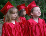 Cassie Hamacher and Caleb Jones (5 yrs) wait for their Pre-School Graduation Certificate from Step...
