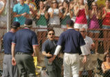 Columbine principal Frank D'Angelis rushes the field to argue with umpires after Wheat Ridge's...