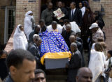 DLM6993  The casket of Yacob Gazaee is carried down the steps of the Ethiopian Orthodox Tewahedo...