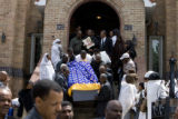 DLM6994  The casket of Yacob Gazaee is carried down the steps of the Ethiopian Orthodox Tewahedo...