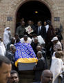 DLM6992  The casket of Yacob Gazaee is carried down the steps of the Ethiopian Orthodox Tewahedo...
