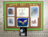 Some of the artwork by Hospice patients participating in  Rudy Ludemann's art class hangs on the...