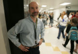 Karl Fisch Arapahoe H.S. Dir . of Technology stands in the hall outside his office Wednesday Oct....