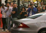 Crowds of onlookers take photographs of Eddie Murphy (cq) as the filming of his new movie...