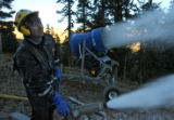 Tommy Neville (cq) checks the direction of a snow gun, Tuesday morning, September 25, 2007, at...