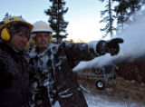 Tommy Neville (cq), left, and Bobby Babeon (cq) decide on a change in the direction of a snow gun,...