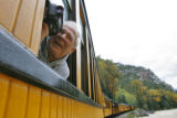 DM3884  John Lahm, 66, of Santa Maria, Calif. leans out the window to record the views from the...