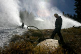 Mark Abrahamson (cq), right, and Aaron Peyzouse (cq) prepare to shut down snow making, Tuesday...