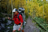 Sam Nay (cq), Waco Texas, heads up the trail to Crater Lake,  September, 19, 2007, near Aspen....