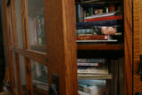"Within this bookcase in her home, is the basis in research for ""All Clear"" a new novel..."