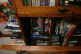 "The bookcase housing all the research materials for a ww2 based novel entitled ""All..."