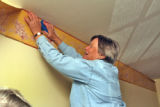 Julie Hughes (cq) works on wallpapering the Bradford Press House in Central City Tuesday ...