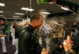 [ES0633] Colorado Rockies pinch hitter Jeff Baker gets drenched with Champaign in the locker room...