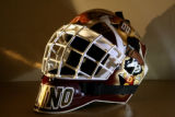 DU's Peter Mannino's goalie helmet, which is decorated in distinctive and colorful fashion. (AHMAD...