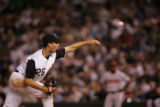 Colorado Rockies Jeff Francis, cq, pitches in the fourth against the Arizona Diamondbacks Friday...