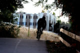 A cyclist rides past Kennedy Ridge, a 1059 unit apartment complex at 10700 E. Dartmouth Avenue on...