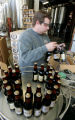Tommyknockers bottler Randy Nelson (cq)  packs freshly bottled Cocoa Porter into cases as the...