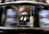 Tommyknockers bottler Randy Nelson (cq)  (cq) packs freshly bottled Cocoa Porter into cases as the...