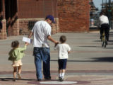 Denver, 9/27/07. Cody Mejilla (cq) walks off with his 5 year-old son Joe Jo Mejilla (CQ) and his 3...
