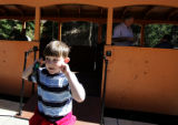 Devin Lester (CQ), 8, of Scottsdale, Arizona closes his ears as the Georgetown Loop Historic...