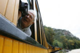 DM0085  John Lahm, 66, of Santa Maria, Calif. leans out the window to record the views in the Las...