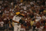 Manny Corpas wipes sweat from his head in the ninth inning of game 2 of the Colorado Rockies...
