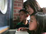Jessica Byun (cq) and her two children Sylvia, 7 left, and Elvin, 9 from Arapaho County get...