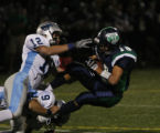 Ralston Valley #12 Colby Allen and #9 Justin Mihalcin take down Thunder Ridge's #18 Will Palamet...