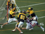 Denver, Colo., photo taken May 18, 2004-Arapahoe's golie Peyton Tvrie (left #00) makes a save in...