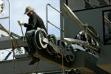 Mathew Hartford, tightens bolts on the new Panoramic Express lift, Tuesday morning, October 9,...