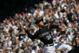 [JOE0258] Colorado Rockies pitcher Ubaldo Jimenez delivers a pitch in the fifth inning of the...