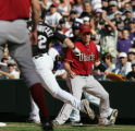 [JOE0396] Colorado Rockies Troy Tulowitzki, left, takes first base on Arizona Diamondbacks first...