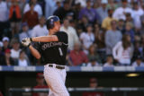 KNP00815 The Colorado Rockies right fielder Brad Hawpe hits a double to deep right field Sunday,...