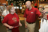 Alan Fey talks to Marji Bell (cq), leftm at the Team Store at Chase Field in Phoenix on Thursday...