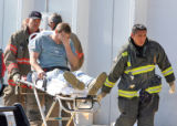 An injured worker is taken from the Colorado Paint Company at 4747 Holly Street shortly after noon...