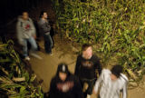 A group of wanderers gets lost in the corn maze at the Botanic Gardens at Chatfield in Littleton,...
